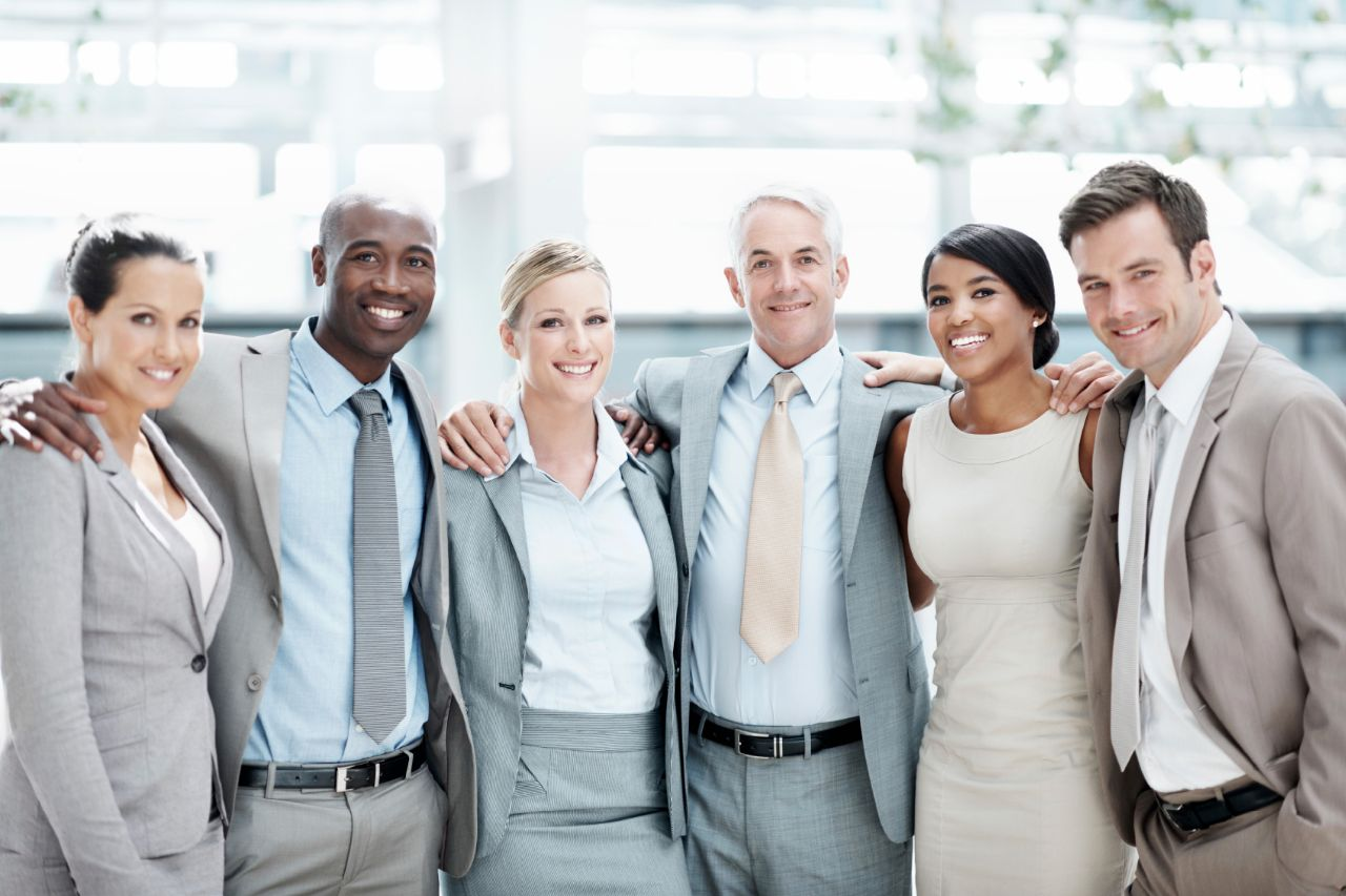 Business companions stand in a row together while in the office